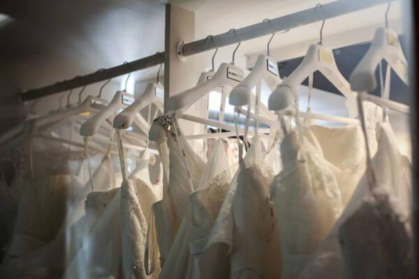 wedding dresses on coat hangers