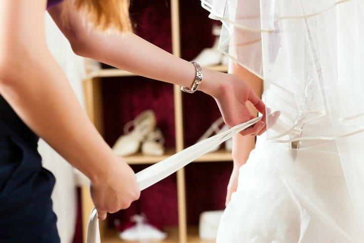 woman-wedding-dress-help